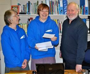 Justine Hobbs (centre), at Bridgebuilders Christian Trust, receives a BGOT grant cheque.