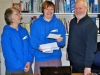 Justine Hobbs (centre), at Bridgebuilders Christian Trust, receives a BGOT grant cheque.